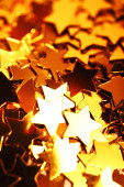 Christmas background with golden stars — Stock Photo