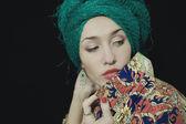 Portrait of woman wearing a woman's headdress — Stock Photo
