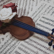 Old violin with musical notes and rose — Stock Photo #70531171
