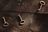 Old lost key on floorboards — Stock Photo