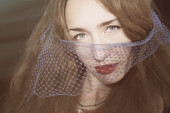Young beautiful woman in the veil — Stock Photo