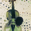 Old violin with musical notes and rose closeup — Stock Photo #72679153