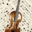 Old violin with musical notes — Stock Photo #73409127
