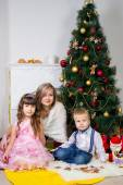 Happy mother and two her children in Christmas — Stock fotografie