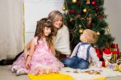 Happy mother and two her children in Christmas — Stock Photo