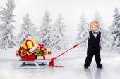 Little boy drags a huge heap of Christmas gifts — Stock fotografie