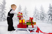 Children carry a heap of gifts on a sledge. — 图库照片