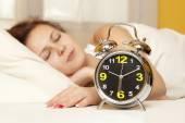 Woman sleeps in the bedroom — Stock Photo