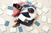 Woman and man reading book — Stock Photo