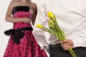 Man hiding bouquet flowers — Stock Photo