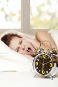 Woman sleeps in the bedroom — Stock Photo