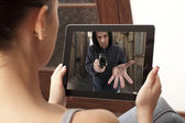 Action  movie on tablet — Stock Photo
