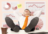 Businessman sleeping at the office — Stock Photo