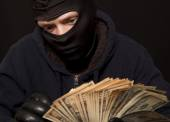 Thief and cash — Stock Photo