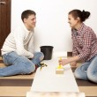 Couple putting new wallpaper — Stock Photo #71938389