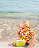 Baby with coconut — Stock Photo