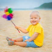 Baby with toy windmill — Stock Photo