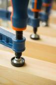Wood pasting by clamps in a joiner's workshop — Stock Photo