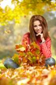 Woman in a park in autumn — Stock Photo