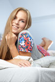 Girl smiling in bed in the morning — Stock Photo