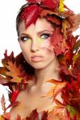 Autumn woman dressed in red leaves — Stock Photo