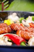 BBQ with fiery sausages on the grill  — Stock Photo