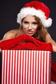 Girl wearing santa claus clothes — Stock Photo