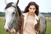 Girl and horse on the walk — Foto de Stock