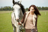 Girl and horse on the walk — Stockfoto