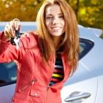 Happy woman with car key — Stock Photo #52938105