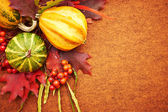 Autumnal background with pumpkins and leaves — Stock Photo