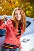 Happy woman with car key — Stock Photo