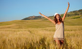 Woman on cereal field in summer — Stock Photo