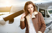 Woman aviator in airport — Stok fotoğraf