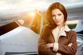 Woman aviator in airport — Stock Photo