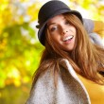 Beautiful woman in golden park — Stock Photo #53800803
