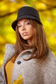 Beautiful woman in golden park — Stock Photo