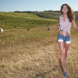 Woman in wheat field — Stock Photo #54339953