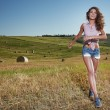 Woman in wheat field — Stock Photo #54339959