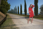 Woman in dress on the road in Tuscany — Stock Photo