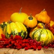 Pumpkins and squashes on wooden table — Stock Photo #54437033