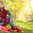 Woman relaxing in autumn forest — Stock Photo #54521871