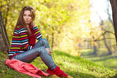 Woman relaxing in autumn forest — Stock Photo