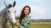 Woman long hair next horse — Stock Photo