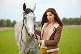 Woman long hair next horse — Stock Photo