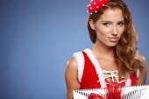 Sexy girl wearing santa claus clothes — Stock Photo