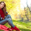 Woman relaxing in autumn forest — Stock Photo #57267799