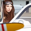 Beautiful woman pilot in front of airplane — Stock Photo #57268175