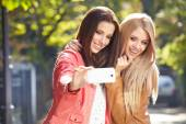 Women making selfie and grimacing — Stock Photo