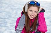 Woman wearing goggles in snowy winter — Stock Photo